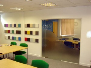Jaga-heating-showing-samples-mounted-on-walls-frameless-partitioning-new-flooring-and-suspended-ceilings